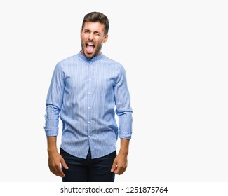 Young handsome man over isolated background sticking tongue out happy with funny expression. Emotion concept.
