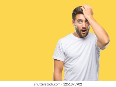 Young handsome man over isolated background surprised with hand on head for mistake, remember error. Forgot, bad memory concept.