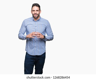 Young handsome man over isolated background Hands together and fingers crossed smiling relaxed and cheerful. Success and optimistic