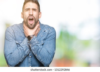 Young handsome man over isolated background shouting and suffocate because painful strangle. Health problem. Asphyxiate and suicide concept.