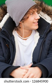 young handsome man portrait with headphones