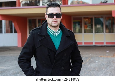 Young Handsome Man Posing in a Black Winter Coat Wearing Sunglasses