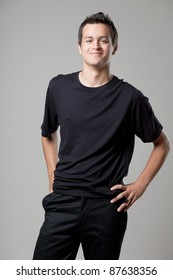 Young handsome man posing in black shirt.