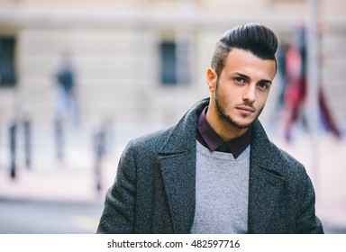 Young handsome man posing on the street.