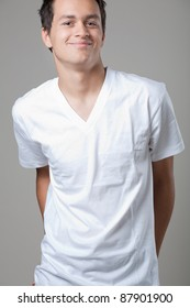 Young handsome man posing in white shirt.