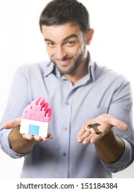 Young Handsome Man presenting Miniature House and Key