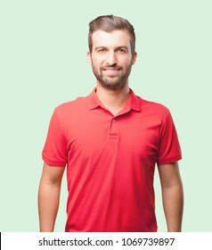 young handsome man proud pose wearing a red polo shirt . person isolated against monochrome background