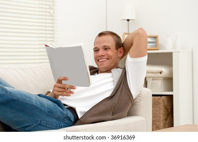 young handsome man reading book