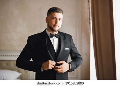 Young handsome man relaxing at his apartment in a hotel after business meeting