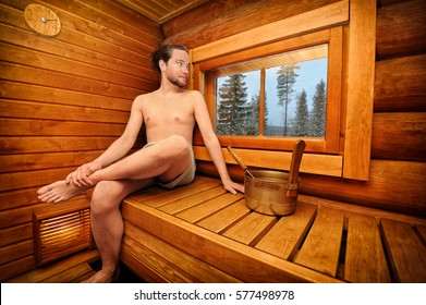 Young handsome man relaxing in sauna