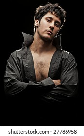 young handsome man in shirt against black background