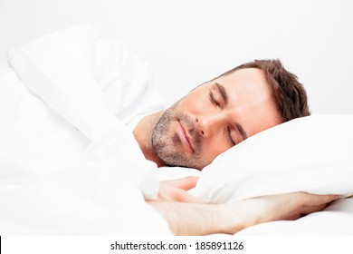 Young handsome man sleeping