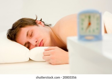 young handsome  man sleeping in his bedroom