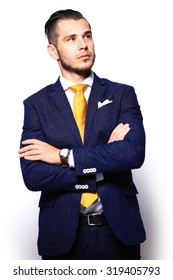 Young handsome man in suit looking at copy-space thinking or dreaming