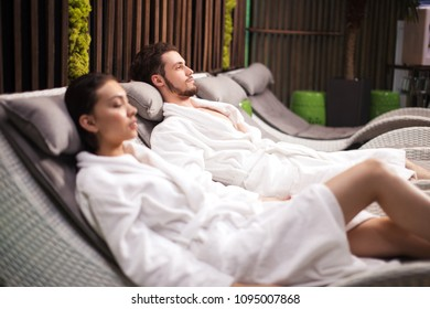 young handsome man taking a rest with his wife in the spa center. close up shot. woman and man caring of their health