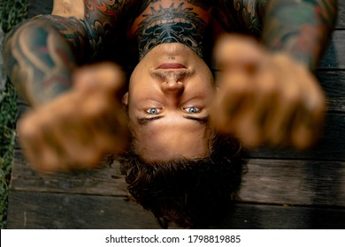 young handsome man in tattoos Close-up portrait.