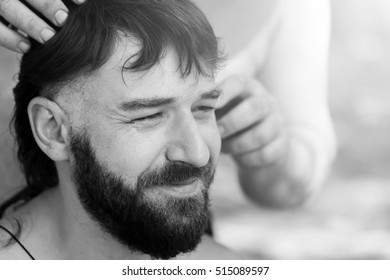 Young handsome man at the time of hair cutting with clipper. Toned