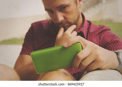 Young handsome man using smartphone.