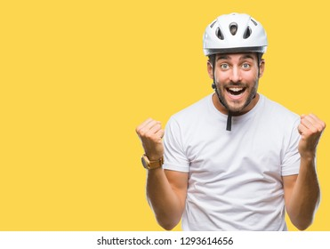 Young handsome man wearing cyclist safety helmet over isolated background celebrating surprised and amazed for success with arms raised and open eyes. Winner concept.