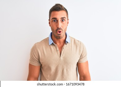Young handsome man wearing elegant t-shirt over isolated background afraid and shocked with surprise expression, fear and excited face.
