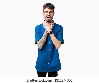 Young handsome man wearing glasses over isolated background shouting and suffocate because painful strangle. Health problem. Asphyxiate and suicide concept.