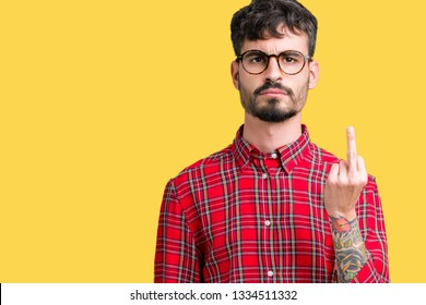 Young handsome man wearing glasses over isolated background Showing middle finger, impolite and rude fuck off expression