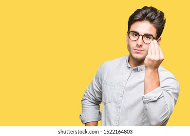 Young handsome man wearing glasses over isolated background Doing Italian gesture with hand and fingers confident expression