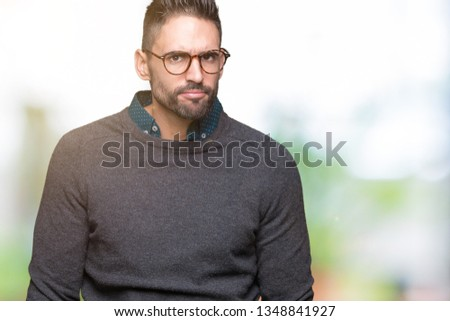 ddbbaad5eb0 Young handsome man wearing glasses over isolated background skeptic and  nervous