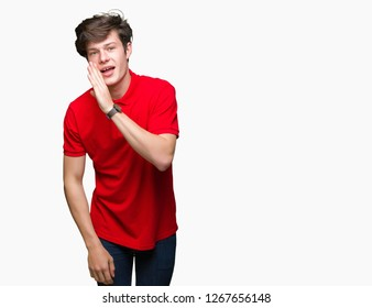 Young handsome man wearing red t-shirt over isolated background hand on mouth telling secret rumor, whispering malicious talk conversation