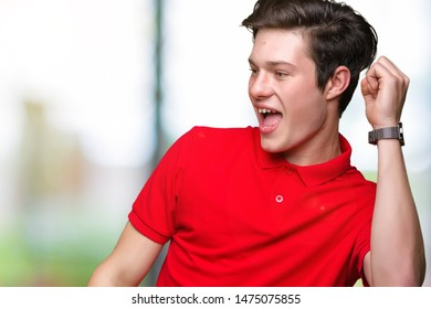 Young handsome man wearing red t-shirt over isolated background Dancing happy and cheerful, smiling moving casual and confident listening to music