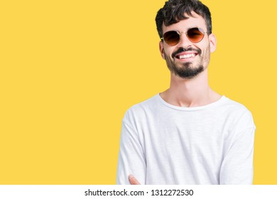c3c197a644 Young handsome man wearing sunglasses over isolated background happy face  smiling with crossed arms looking at