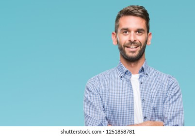 Young handsome man wearing white t-shirt over isolated background happy face smiling with crossed arms looking at the camera. Positive person.