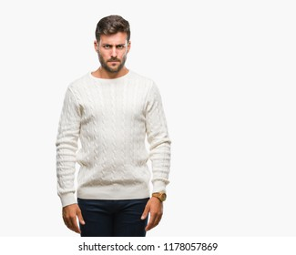 Young handsome man wearing winter sweater over isolated background skeptic and nervous, frowning upset because of problem. Negative person.