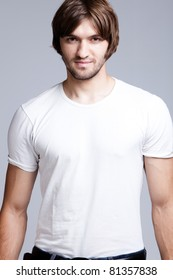 young handsome man in white t-shirt, studio shot