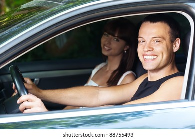 young handsome man and woman sitting car background summer green park