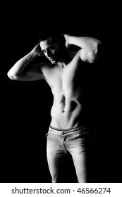 Young handsome muscled man in studio shoot.