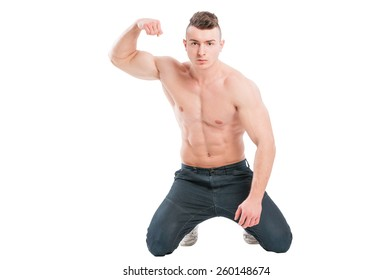 Young, handsome and muscular male model on his knees