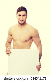 Young handsome nude man covering his self with empty banner.