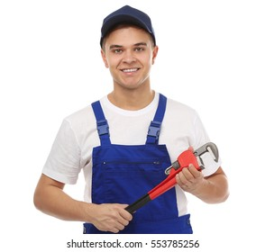 Young handsome plumber with pipe wrench on white background