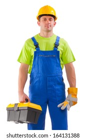 a young handsome plumber worker with adjustable wrench. Isolated over white background