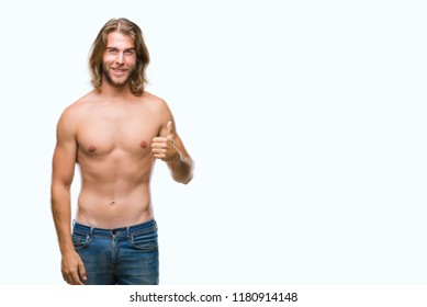 Young handsome shirtless man with long hair showing sexy body over isolated background doing happy thumbs up gesture with hand. Approving expression looking at the camera with showing success.