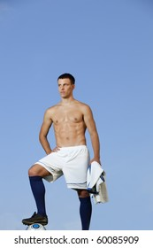 Young handsome shirtless soccer player