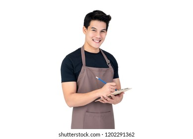 Young handsome smiling Asian man barista taking order with service mind, studio shot isolated on white background