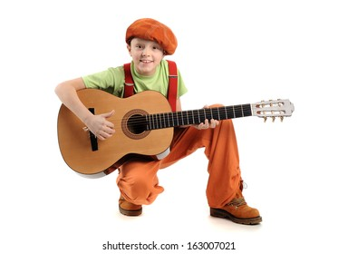Young handsome smiling boy playing guitar