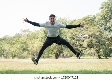 Young handsome sport man jumping training outdoors healthy lifestyle and sport concept.