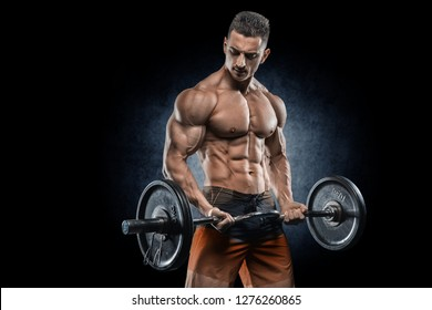 Young handsome sportsman bodybuilder weightlifter with an ideal body