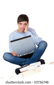 Young handsome student sitting frustrated at laptop and learns. Isolated on white.