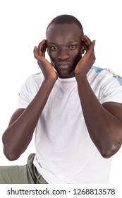 Young handsome Sudanese man face to camera hands to temples indicating headache or stress relief in portrait format with copy space for emotions isolated on white background. Painful