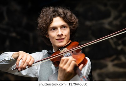 young handsome violinist