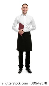 Young handsome waiter holding restaurant menu on white background